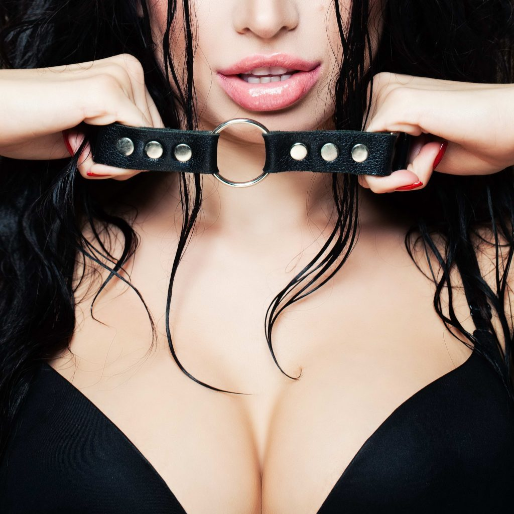 Sexy Busty Brunette in BDSM